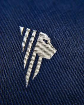 Tie lion logo detail